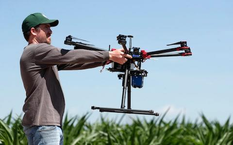 Farmers have turned to drones to improve their crop yield and reduce the amount of waste they generate - Credit: David Zalubowski/AP