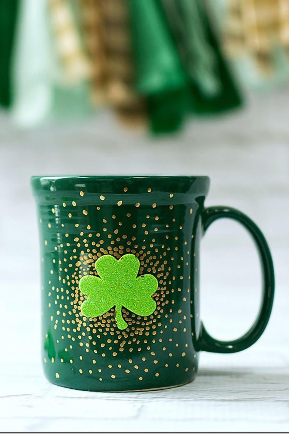 """<p>Enjoy the holiday while you sip coffee or tea with this festive mug.</p><p><strong>Get the tutorial at <a href=""""http://www.itallstartedwithpaint.com/irish-coffee-mugs/"""" rel=""""nofollow noopener"""" target=""""_blank"""" data-ylk=""""slk:It All Started with Paint"""" class=""""link rapid-noclick-resp"""">It All Started with Paint</a>.</strong></p><p><strong><a class=""""link rapid-noclick-resp"""" href=""""https://www.amazon.com/Krylon-K09901A00-Leafing-Gold-Ounce/dp/B003ZTNENS/ref=sr_1_8?tag=syn-yahoo-20&ascsubtag=%5Bartid%7C10050.g.4035%5Bsrc%7Cyahoo-us"""" rel=""""nofollow noopener"""" target=""""_blank"""" data-ylk=""""slk:SHOP GOLD PEN"""">SHOP GOLD PEN</a><br></strong></p>"""