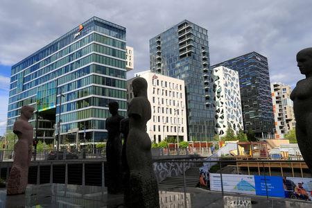 FILE PHOTO: Buildings are seen in the financial district in Oslo, Norway May 31, 2017. REUTERS/Ints Kalnins/File Photo