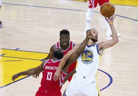 May 20, 2018; Oakland, CA, USA; Golden State Warriors guard Stephen Curry (30) extends for the ball against Houston Rockets guard James Harden (13) during the third quarter of game three of the Western conference finals of the 2018 NBA Playoffs at Oracle Arena. Mandatory Credit: Kelley L Cox-USA TODAY Sports