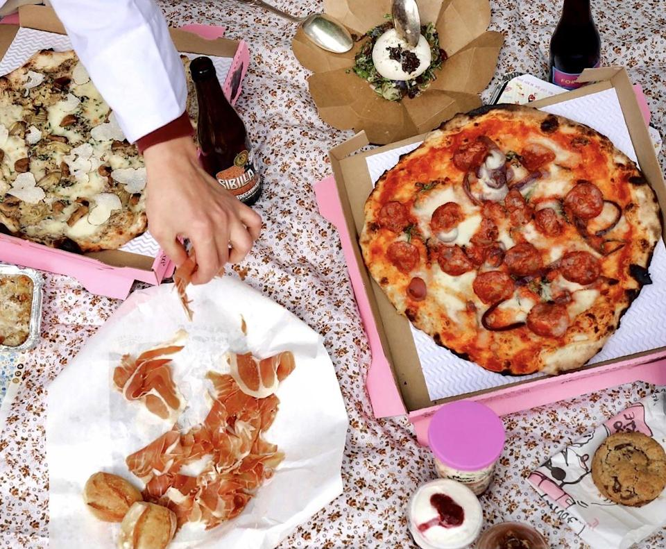 """<p>If all your favourite restaurant spots are booked out in London town, head to a park and enjoy the perks of the la dolce vita with an Italian classic from <a href=""""https://napoligang.co.uk/"""" rel=""""nofollow noopener"""" target=""""_blank"""" data-ylk=""""slk:Napoli Gang"""" class=""""link rapid-noclick-resp"""">Napoli Gang</a>. Antipasti, pizzas, dolci and drinks (plus that</p><p>tiramisu) are all up for grabs via Deliveroo or UberEats all day long at Victoria Park, Hampstead Heath, Finsbury Park, Alexandra Park, Wimbledon Common, Putney Common and Wandsworth Common. Tutto bene!</p>"""