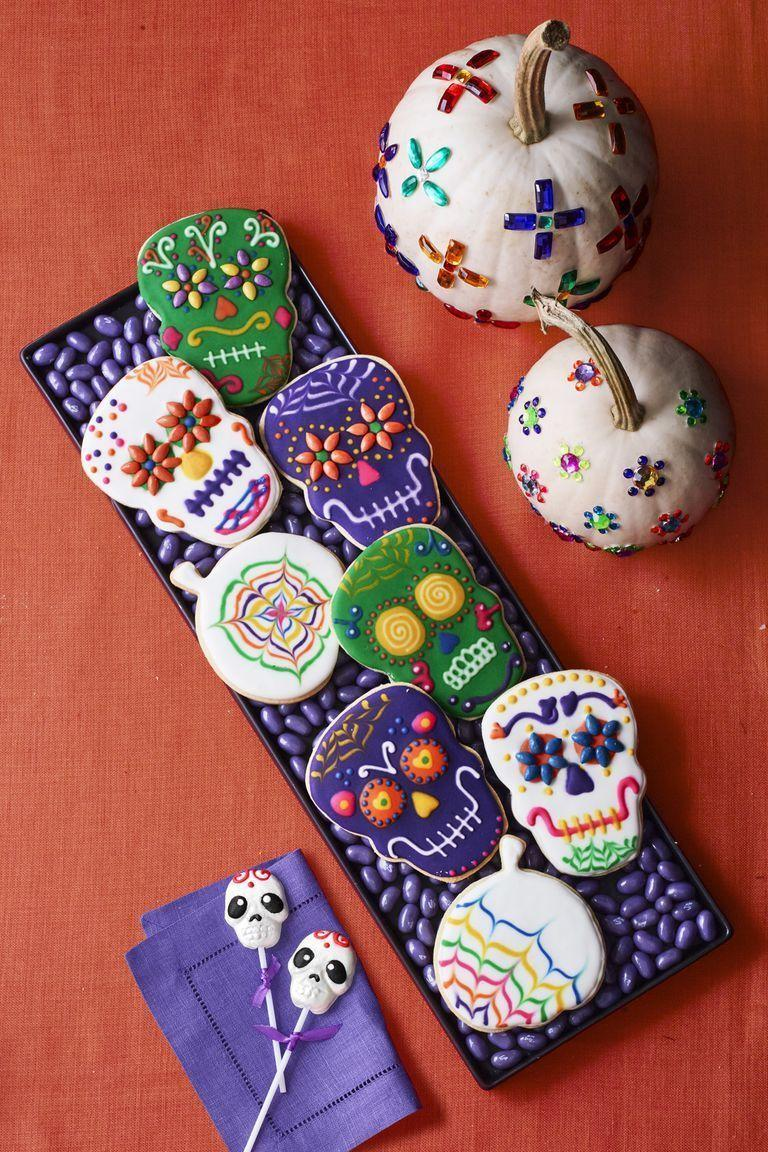 """<p>Amp up the color on your dessert table with these Mexican-inspired sugar cookies topped with simple royal icing.</p><p><em><a href=""""https://www.womansday.com/food-recipes/food-drinks/a23569445/cookie-skulls-and-pumpkin-sugar-cookie-cutouts-recipe/"""" rel=""""nofollow noopener"""" target=""""_blank"""" data-ylk=""""slk:Get the recipe from Woman's Day »"""" class=""""link rapid-noclick-resp"""">Get the recipe from Woman's Day »</a></em></p><p><strong>RELATED: </strong><a href=""""https://www.goodhousekeeping.com/holidays/halloween-ideas/g1394/halloween-party-snacks/"""" rel=""""nofollow noopener"""" target=""""_blank"""" data-ylk=""""slk:55 Creative Halloween Party Snacks That Are Equally Creepy and Cute"""" class=""""link rapid-noclick-resp"""">55 Creative Halloween Party Snacks That Are Equally Creepy and Cute</a><br></p>"""