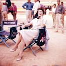 <p>Ava Gardner sits back and relaxes with a Coca-Cola while on the set of her film <em>The Sun Also Rises</em>, which she shot in France and Spain. </p>