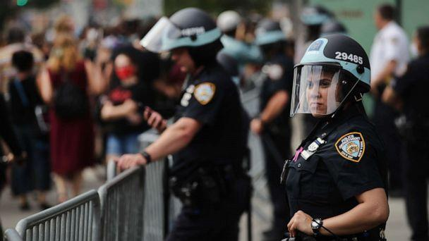PHOTO: Police watch as hundreds of protesters march in downtown Brooklyn over the killing of George Floyd by a Minneapolis Police officer, June 05, 2020, in New York City. (Spencer Platt/Getty Images)