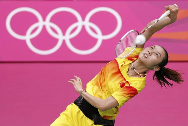 China's Wang Yihan returns a shot to compatriot Li Xuerui during their women's singles badminton gold medal match at the London 2012 Olympic Games at the Wembley Arena August 4, 2012. REUTERS/Bazuki Muhammad (BRITAIN - Tags: SPORT BADMINTON OLYMPICS TPX IMAGES OF THE DAY)