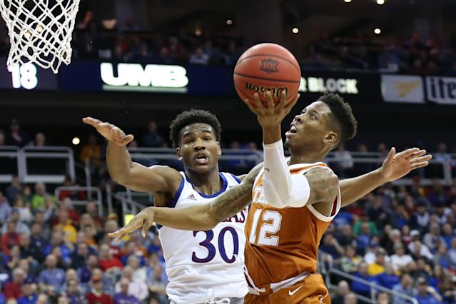 KANSAS CITY, MO - MARCH 14: Texas Longhorns guard Kerwin Roach II (12) tries to convert after being fouled by Kansas Jayhawks guard Ochai Agbaji (30) in the first half of a quarterfinal Big 12 tournament game between the Texas Longhorns and Kansas Jayhawks on March 14, 2019 at Sprint Center in Kansas City, MO. (Photo by Scott Winters/Icon Sportswire via Getty Images)