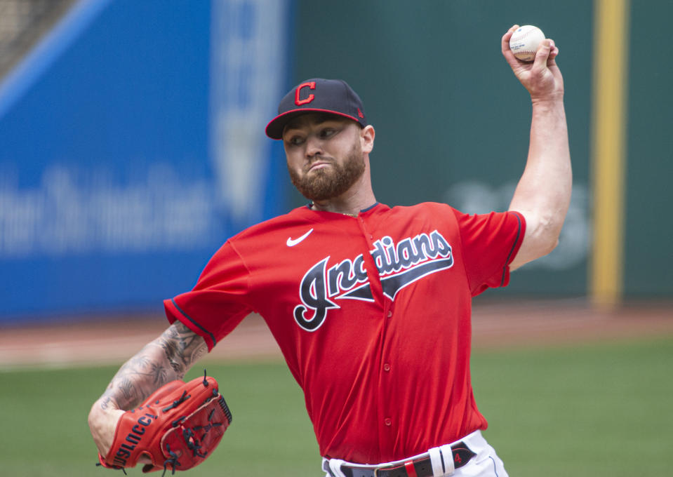 Cleveland Indians starting pitcher Logan Allen delivers against the Detroit Tigers during the first inning of a baseball game in Cleveland, Sunday, April 11, 2021. (AP Photo/Phil Long)
