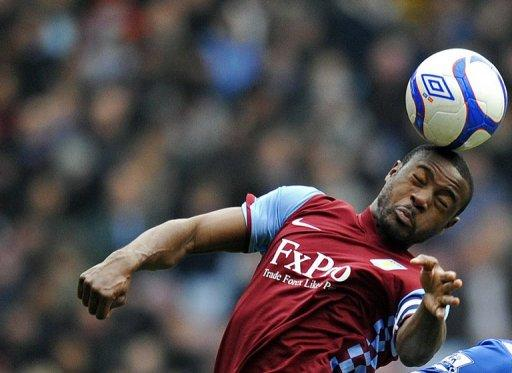 Nigel Reo-Coker has completed his move to Bolton Wanderers, the club announced