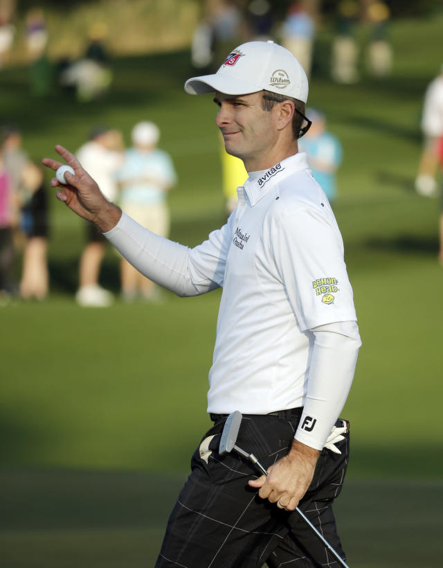 Kevin Streelman holds up his ball after a birdie on the second hole during the second round of the Masters golf tournament Friday, April 11, 2014, in Augusta, Ga. (AP Photo/Chris Carlson)