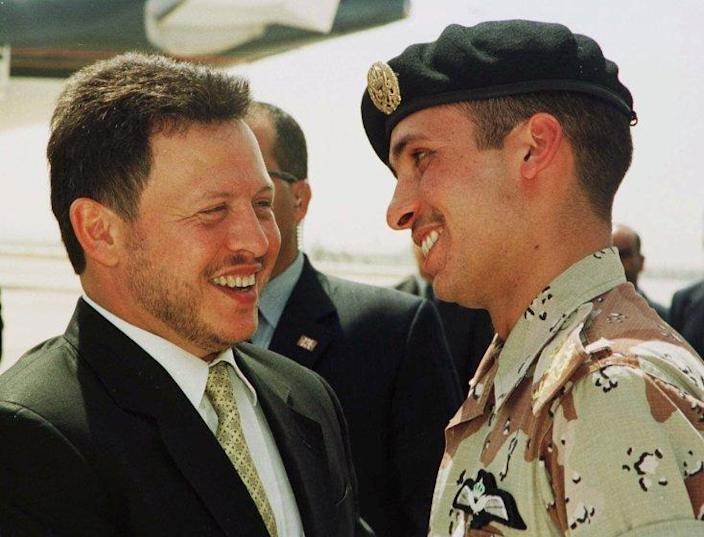 FILE - In this April 2, 2001, file photo, Jordan's King Abdullah II laughs with his half brother Prince Hamzah, right, shortly before the monarch embarked on a tour of the United States. Prince Hamzah said in a recording released Monday, April 5, that he will defy government threats ordering him to stay at home and refrain from public statements following accusations he was behind a plot to destabilize the kingdom. (AP Photo/Yousef Allan, File)