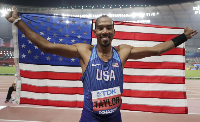Christian Taylor, of the United States, celebrates after winning the gold medal in the men's triple jump final at the World Athletics Championships in Doha, Qatar, Sunday, Sept. 29, 2019. (AP Photo/Hassan Ammar)