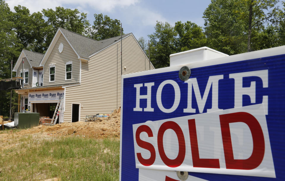 FILE - In this Monday, June 8, 2015 file photo, a sold sign is posted in front of a new home under construction in Mechanicsville, Va. Sales of new homes plunged sharply in September to the slowest pace in 10 months, according to Commerce Department report released Monday, Oct. 26, 2015, as higher prices and slower overall economic growth weigh on the housing market. (AP Photo/Steve Helber, File)