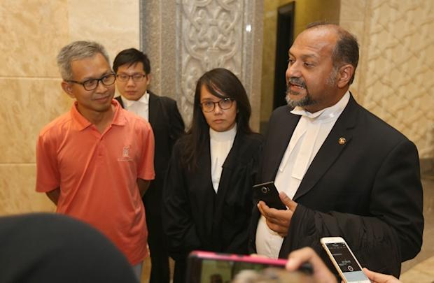 Petaling Jaya Utara MP Tony Pua (left) and his lawyer Gobind Singh Deo (right) speak to reporters outside the Court of Appeals in Putrajaya February 14, 2018. — Picture by Razak Ghazali