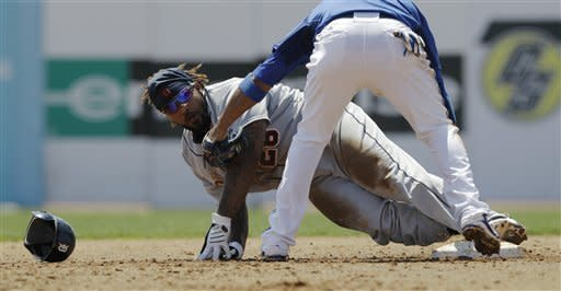 Detroit Tigers' Prince Fielder is safe at second on a third-inning stolen base as Toronto Blue Jays shortstop Yunel Escobar hovers over him during their spring training baseball game in Dunedin, Fla., Tuesday, April 3, 2012. (AP Photo/Kathy Willens)