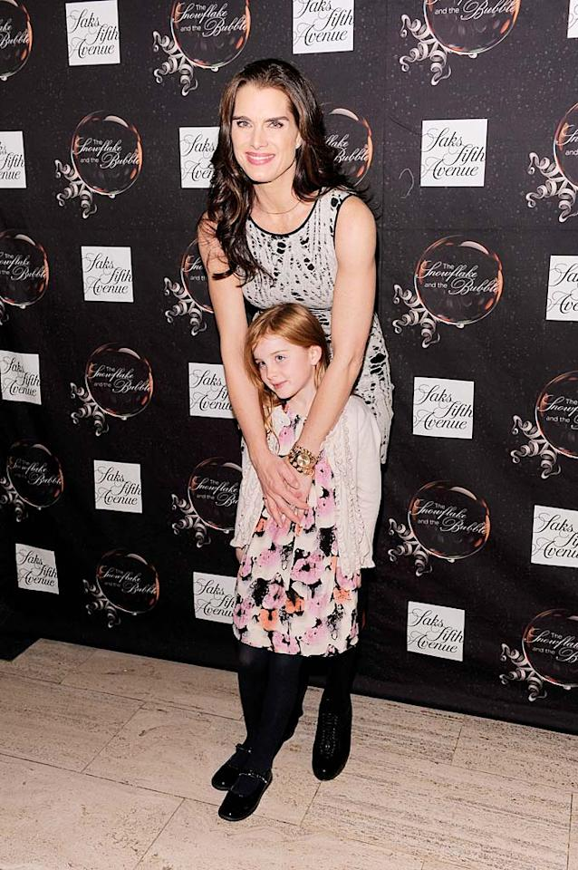 """Brooke Shields took her adorable daughter Rowan Henchy, 7, to see the Saks Fifth Avenue light show spectacle, """"The Snowflake and the Bubble,"""" in New York City. The actress, whose younger daughter Grier is 4, recently revealed that her girls love Katy Perry. """"They love her songs. They know all the lyrics,"""" the actress, told <i>In Touch Weekly<i>. Jemal Countess/<a href=""""http://www.wireimage.com"""" target=""""new"""">WireImage.com</a> - November 22, 2010</i></i>"""