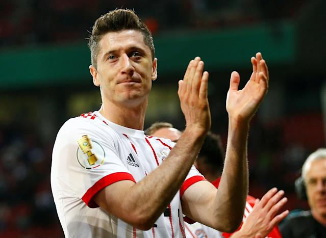 Soccer Football - DFB Cup - Bayer Leverkusen vs Bayern Munich - BayArena, Leverkusen, Germany - April 17, 2018 Bayern Munich's Robert Lewandowski celebrates after the match REUTERS/Thilo Schmuelgen DFB RULES PROHIBIT USE IN MMS SERVICES VIA HANDHELD DEVICES UNTIL TWO HOURS AFTER A MATCH AND ANY USAGE ON INTERNET OR ONLINE MEDIA SIMULATING VIDEO FOOTAGE DURING THE MATCH.