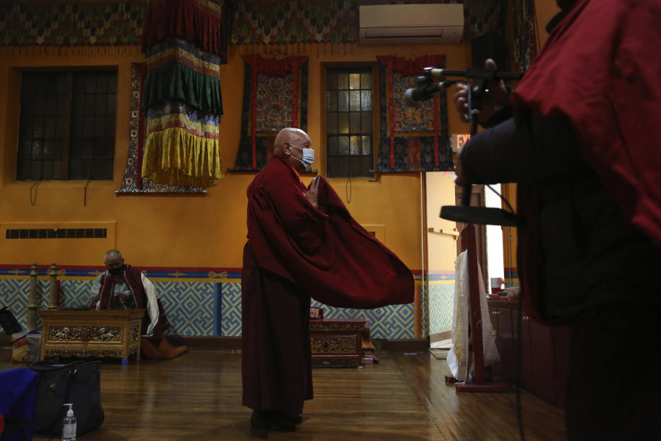 Lama Ngawang Yonten and other Buddhist members of the United Sherpa Association prepare for the Dakini Day practice, a group meditation that includes song and food and is celebrated on the 25th day of each lunar month, at their community temple in the Queens borough of New York on Friday, Jan. 8, 2021. (AP Photo/Jessie Wardarski)