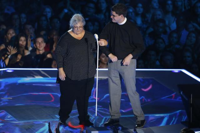 Susan Bro, mother of Heather Heyer, the activist killed during a rally in Charlottesville, Va., earlier this month, is joined on stage by Rev. Robert Wright Lee IV at the 2017 MTV Video Music Awards. (Photo: Mario Anzuoni/Reuters)