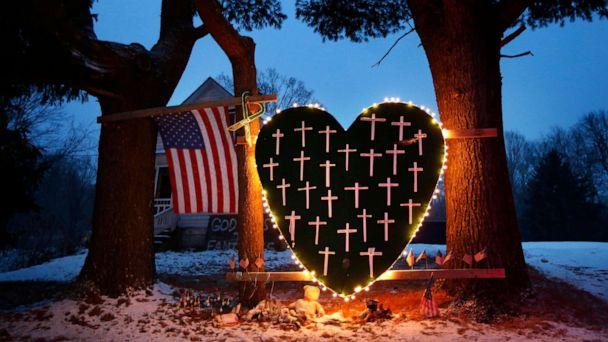PHOTO: In this Dec. 14, 2013 file photo, a makeshift memorial with crosses for the victims of the Sandy Hook massacre stands outside a home in Newtown, Conn. (Robert F. Bukaty/AP, FILE)