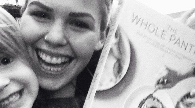 Health and wellness blogger Belle Gibson pictured her with recipe book, The Whole Pantry, which features 'cancer combating' recipes. Photo: Instagram