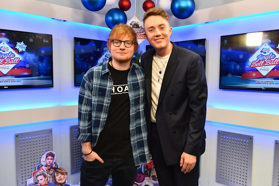 Ed Sheeran is interviewed by presenter Roman Kemp during day two of Capital's Jingle Bell Ball 2017 at the O2 Arena, London.