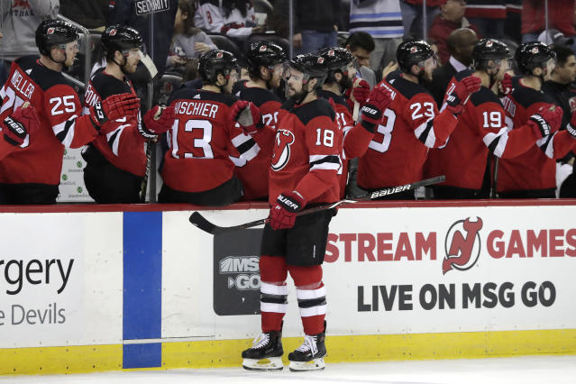 New Jersey Devils right wing Drew Stafford (18) swings by the bench after scoring a goal against the Arizona Coyotes during the first period of an NHL hockey game, Saturday, March 23, 2019, in Newark, N.J. (AP Photo/Julio Cortez)