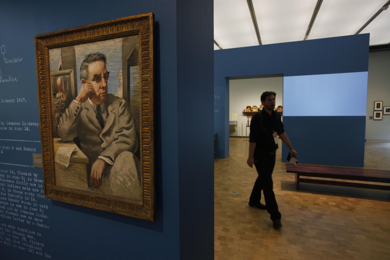 """An oil on canvas portrait by Giorgio de Chirico of Dr. Albert C. Barnes hangs at The Barnes Foundation Wednesday, May 16, 2012, in Philadelphia. After years of bitter court fights, the Barnes Foundation is scheduled to open its doors to the public on May 19 at its new location on Philadelphia's """"museum mile."""" (AP Photo/Matt Rourke)"""