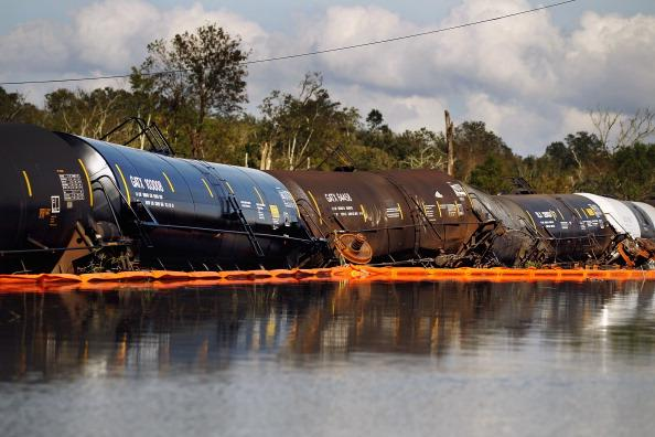 Damaged railroad cars sit in Hurricane Isaac's flood waters on September 1, 2012 in Braithwaite, Louisiana. Louisiana residents continue to cope with the aftermath of Hurricane Isaac with ongoing flooding, destroyed property and many still without electricity. (Photo by Mario Tama/Getty Images)