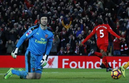 Britain Soccer Football - Liverpool v Arsenal - Premier League - Anfield - 4/3/17 Liverpool's Georginio Wijnaldum celebrates scoring their third goal as Arsenal's Petr Cech looks dejected Reuters / Phil Noble Livepic