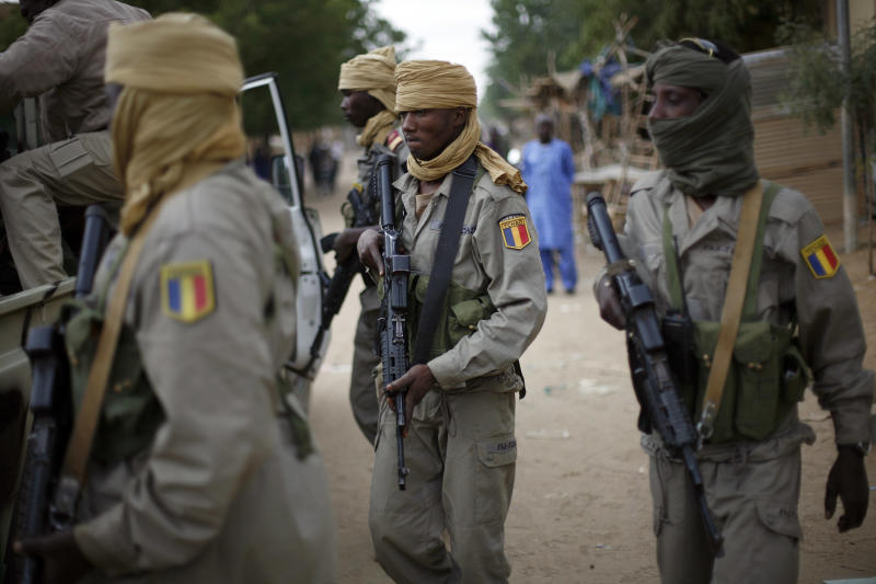 File- In this picture taken Monday Jan. 28, 2013, Chadian soldiers patrol the streets of Gao, Northern Mali. Chadian President Idriss Deby in an interview with French journalists that was posted online Monday April 15, 2013 said his country's troops are pulling out of Mali three months after the French-led mission to oust al-Qaida-linked militants began, raising concerns about the future of war in the absence of the fierce Chadian desert fighters. The drawdown of Chadian forces comes days after a suicide bombing killed three Chadian soldiers.(AP Photo/Jerome Delay-File)