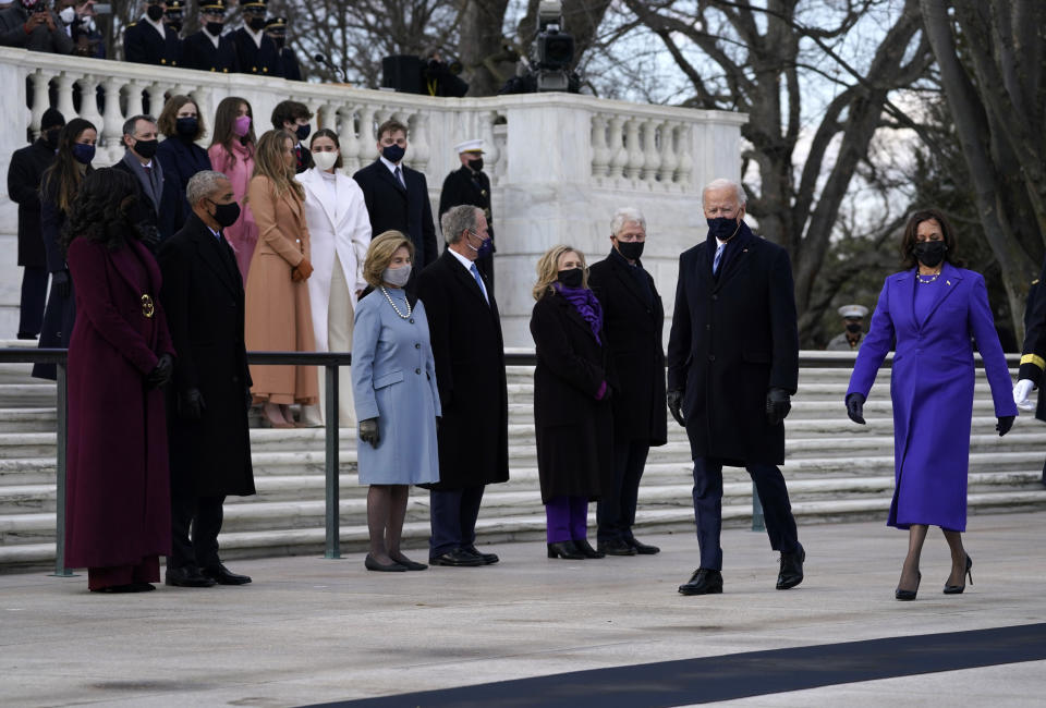 President Joe Biden and Vice President Kamala Harris arrive at the Tomb of the Unknown Soldier at Arlington National Cemetery during Inauguration Day ceremonies in Arlington, Va. Former President Barack Obama and his wife Michelle, former President George W. Bush and his wife Laura and former President Bill Clinton and his wife former Secretary of State Hillary Clinton and family look on. (AP Photo/Evan Vucci)