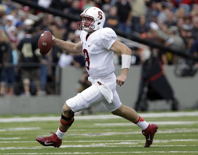 Stanford quarterback Kevin Hogan (8) looks to pass against Army during the first half of an NCAA college football game on Saturday, Sept. 14, 2013, in West Point, N.Y. (AP Photo/Mike Groll)