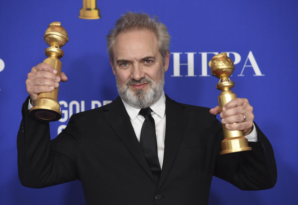 """Sam Mendes with the awards for best director, motion picture and best motion picture drama for """"1917"""" at the 77th Golden Globe Awards. (AP Photo/Chris Pizzello)"""