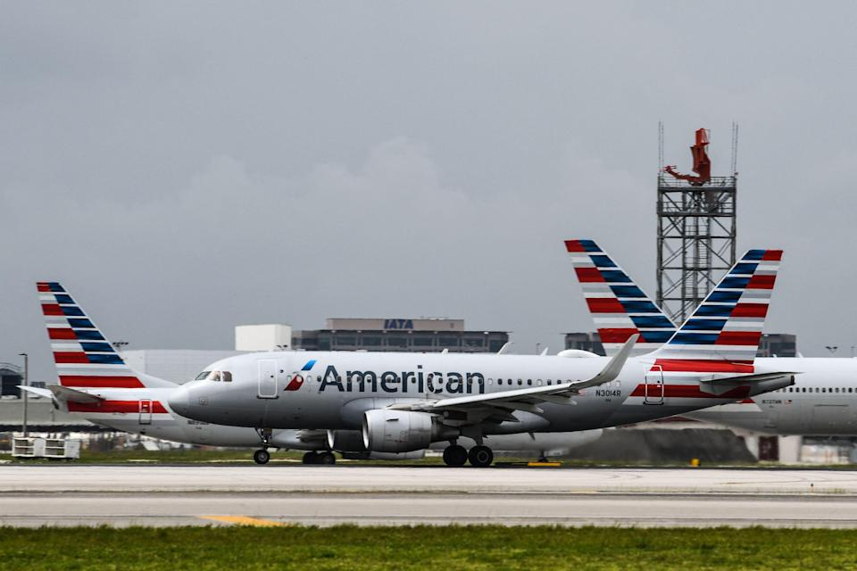 American Airlines planes taxi at Miami International Airport in Miami on June 16, 2021.