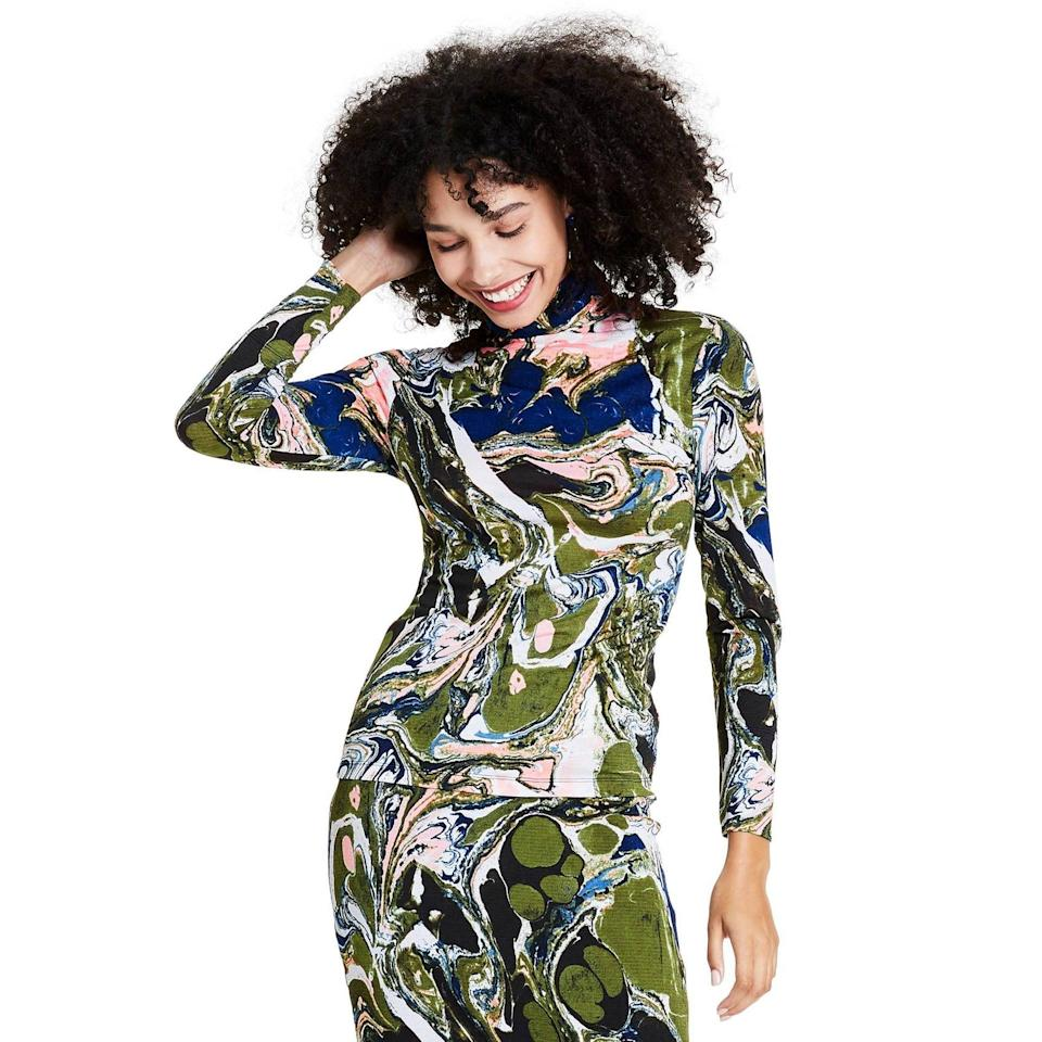 <p>Go all out and get the <span>Rachel Comey x Target Marble Print Long Sleeve Textured Turtleneck Shirt</span> ($30) and <span> Knit Pencil Skirt </span> ($30) set. The fun pieces are easy to mix and match with other pieces in your closet.</p>