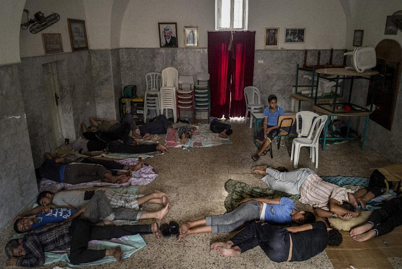 Displaced Palestinians sleep on the floor inside Gaza City's Greek Orthodox church on July 23, 2014 (AFP Photo/Marco Longari)