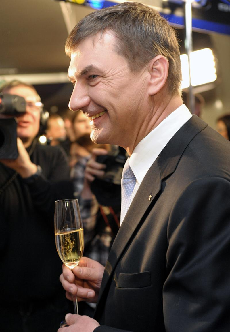 Estonia's Prime Minister Andrus Ansip celebrates preliminary results at his party headquarters after the parliamentary elections in Tallinn, Estonia, early Monday, March 7, 2011. Estonia's center-right government is poised to stay in power for a second term after winning a clear parliamentary majority in the Baltic country's first election as a eurozone member, preliminary results showed. (AP Photo/Timur Nisametdinov, NIPA)