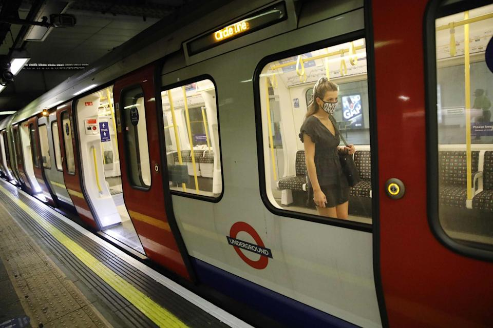 A woman wearing a mask on the Tube (AFP via Getty Images)