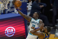 Charlotte Hornets guard Terry Rozier, top, shoots over Golden State Warriors center Kevon Looney during the second half of an NBA basketball game in San Francisco, Friday, Feb. 26, 2021. (AP Photo/Jeff Chiu)