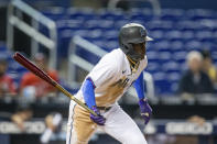 Miami Marlins second baseman Jazz Chisholm Jr. (2) runs to first base during the fifth inning of a baseball game against the Washington Nationals on Thursday, June 24, 2021, in Miami. (AP Photo/Mary Holt)