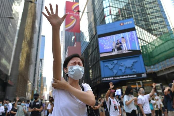 Hong Kong's protesters are demanding the right to elect their leaders (AFP Photo/Nicolas ASFOURI)