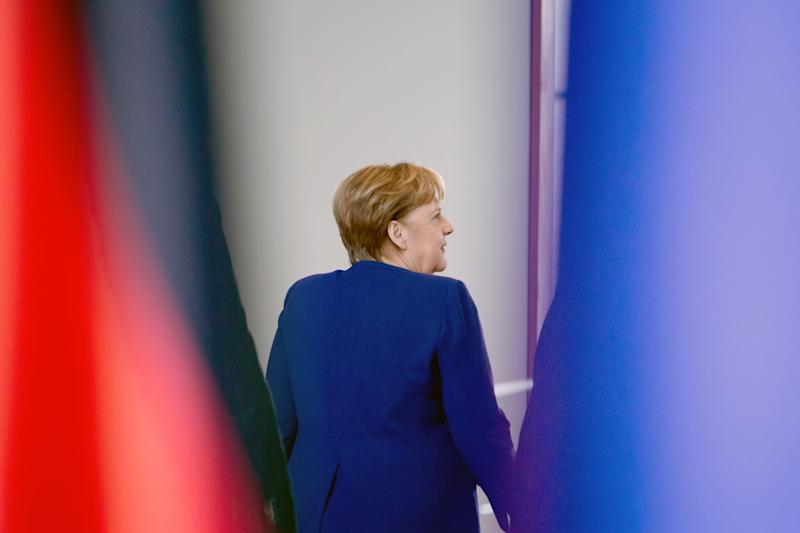 """14 February 2020, Berlin: Chancellor Angela Merkel leaves the room after the presentation of the current 2-euro commemorative coin """"Brandenburg"""" in the Federal Chancellery. This year, the 2-euro special coin pays tribute to the state of Brandenburg. Photo: Christoph Soeder/dpa (Photo by Christoph Soeder/picture alliance via Getty Images) (Photo: picture alliance via Getty Images)"""