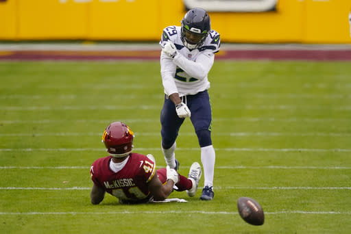 Seattle Seahawks free safety D.J. Reed (29) reacting after stopping Washington Football Team running back J.D. McKissic (41) from catching the ball during the first half of an NFL football game, Sunday, Dec. 20, 2020, in Landover, Md. (AP Photo/Andrew Harnik)