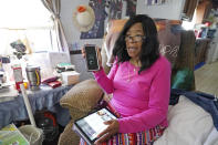 Mary Christian, 71, of McComb, Miss., recalls Friday, Jan. 15, 2021, the hours she spent on both her cell phone and iPad trying to arrange an appointment online for a COVID-19 vaccination through the Mississippi State Department of Health website and on their listed registration phone line. Eventually, with help from one of her sons, she was able to enter the registration site only to find vaccination locations with openings were at least an hour's drive from the county she lives in and upon trying to sign up was informed they had no more openings. (AP Photo/Rogelio V. Solis)