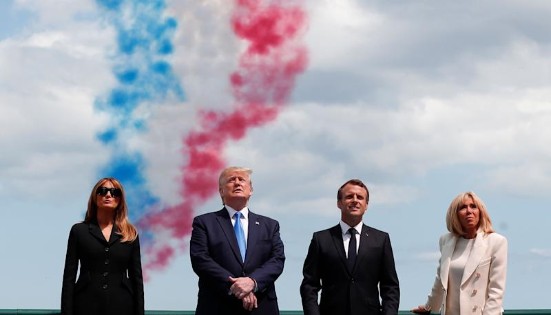 U.S President Donald Trump, U.S First Lady Melania Trump, left, French President Emmanuel Macron, second right, and his wife Brigitte Macron, right, attend a ceremony to mark the 75th anniversary of D-Day at the Normandy American Cemetery in Colleville-sur-Mer, Normandy, France, Thursday, June 6, 2019. World leaders are gathered Thursday in France to mark the 75th anniversary of the D-Day landings. (Ian Langsdon/POOL via AP)