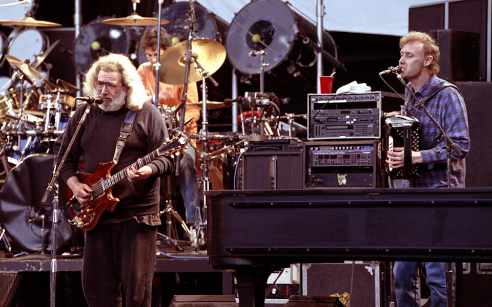 Bruce Hornsby on stage with The Grateful Dead's Jerry Garcia, in 1991 - Getty