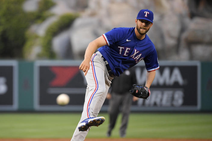 Texas Rangers starting pitcher Jordan Lyles watches as Los Angeles Angels' Jared Walsh hits a single during the first inning of a baseball game against the Los Angeles Angels Tuesday, April 20, 2021, in Anaheim, Calif. (AP Photo/Mark J. Terrill)
