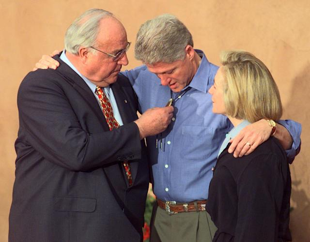 <p>Germany's Chancellor Helmut Kohl (L) admires the western style bolo tie worn by U.S. President Bill Clinton as First Lady Hillary Clinton watches at The Fort Restaurant at the Dever Summit of the Eight, June 21, 1997. Clinton had asked the leaders to wear cowboy boots and casual wear to the dinner, however, Kohl refused and kept to the standard coat and tie. (Gary Hershorn/Reuters) </p>