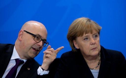 (L-R) Thorsten Albig, Schleswig Holstein's State Premier and German Chancellor Angela Merkel