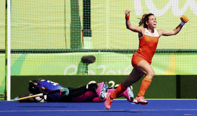<p>Ellen Hoog of Netherlands (R) celebrates after scoring the winning goal during the penalty shootout against Germany in the women's hockey semifinals at the Olympic Hockey Center on August 17, 2016. (REUTERS/Vasily Fedosenko) </p>